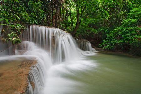 Huay Mae Khamin Waterfall Third Level, Paradise waterfall in Tropical rain forest of Thailand photo