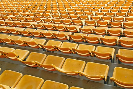 baseball crowd: Perspective of yellow seats in football stadium, pattern background Stock Photo