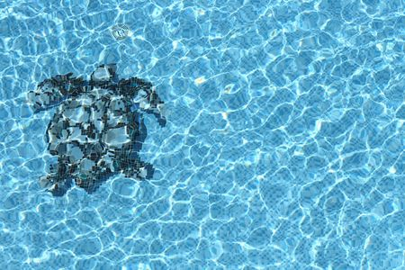 Refection of Blue water in Sea Turtle mosaic Swimming pool with Ripple photo