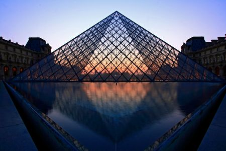 tourist destinations: Paris France APR 16,2010: Closeup of Silhouette Pyramid shines at dusk during the Summer Exhibition in Paris. This is one of the most popular tourist destinations in France.