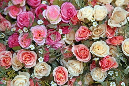flowery: Heap of Fake rose flower using as love and beauty conceptual background