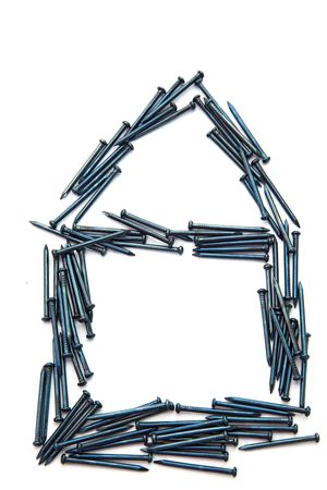 Conceptual of blue steel nail construction house photo