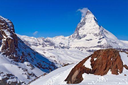 Landscape of Matterhorn peak with Red rock located at Gornergrat in Switzerland photo