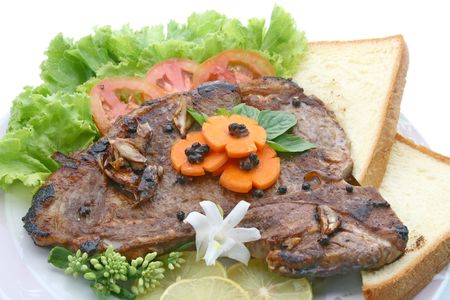 t bone: T Bone Pepper Steak with vegetable and bread, closeup Stock Photo