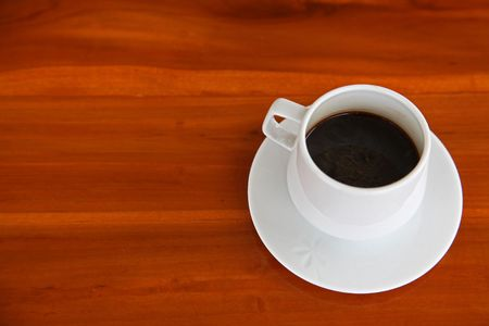 White Cup of Hot Espresso coffee on Wooden Table photo