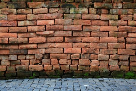 irregular shapes: irregular shapes of red stone brick wall with pavement Stock Photo