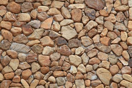 irregular shapes: Muro de ladrillo tradicional hecha de piedras de fragmento en formas irregulares