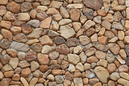 Traditional Stone Brick Wall made of fragment stones in irregular shapes photo