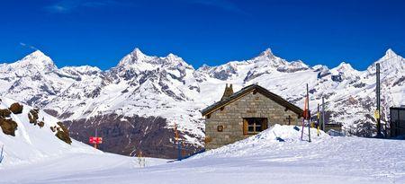chocolate peak: Panoramic view of Swiss alps with Train Station located at Gornergrat in Switzerland  Stock Photo