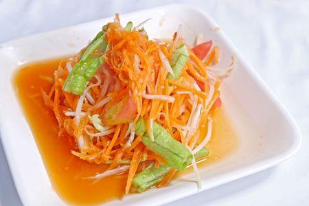 Hot and spicy papaya and carrot salad  photo