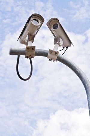 Surveillance Security Camera or CCTV on blue sky Stock Photo - 8089398
