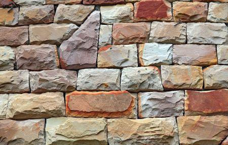 irregular shapes: Fondo de pared de ladrillo de modernas formas irregulares de piedra roja