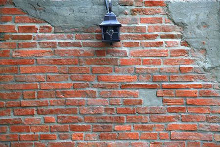 Under construction of Red brick wall with lamppost photo