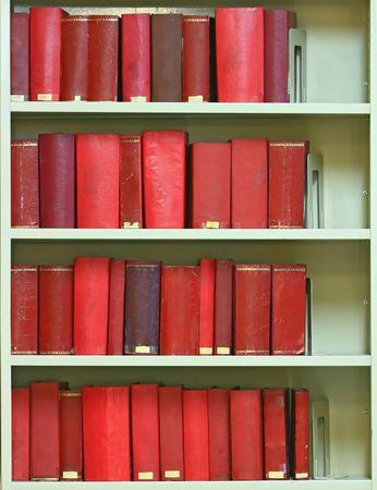 red old hardcover books on bookshelf photo