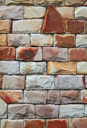 irregular shapes: Fondo de pared, vertical de ladrillo de modernas formas irregulares de piedra roja