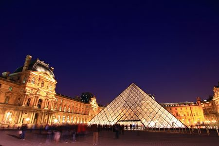 chateau: PARIS-APRIL 16: Louvre pyramid at Evening during the Summer Antiquities Exhibition April 16, 2010.Louvre is the biggest Museum in Paris displayed over 60,000 square meters of exhibition space. Editorial