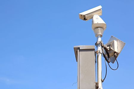 isolated Surveillance Security Camera or CCTV on blue sky, right perspective Stock Photo - 8089759
