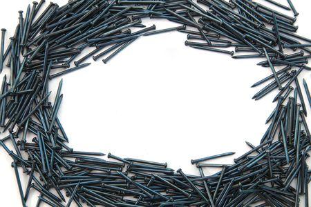 hobby hut: elliptical frame of blue Concrete nails Stock Photo