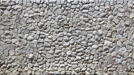 irregular shapes: modern white Brick Wall made of fragment stones in irregular shapes