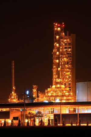 scenic of petrochemical oil refinery plant shines at night, vertical closeup Stock Photo - 8145275
