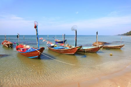 fisherman long tail boat park at the Rayong beach in Thailand Stock Photo - 8145276