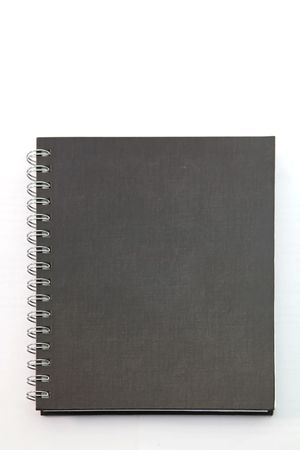 isolated black hard cover notebook with ring binder on white photo