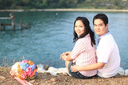 couple sitting outdoors smiling at the beach Stock Photo - 8257872