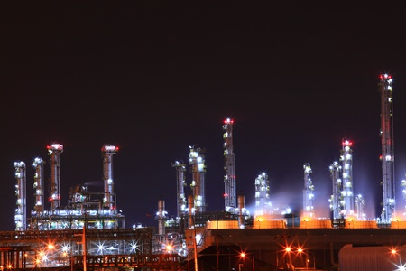 beautiful scenic of petrochemical oil refinery plant shines at night, closeup Stock Photo - 8257889