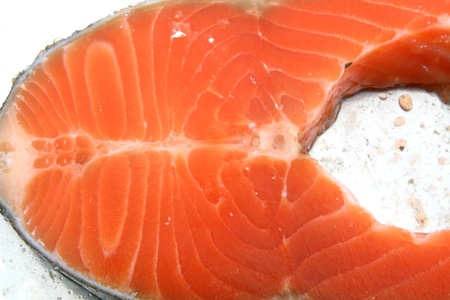 Texture of Fresh cut of Salmon Steak on white plate photo