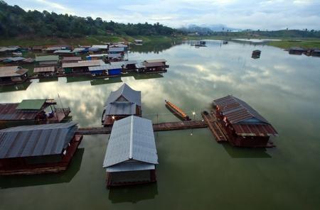 Thai Mon Floating village on the River in Sangkraburi Kanchanaburi Provice Border of Thailand and Myanmar in The Morning photo