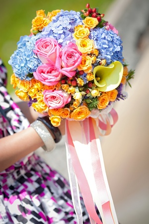 beautiful flower bouquet holded in hand photo