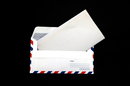 post scripts: perspective of isolated airmail Envelope with blank vintage paper on black background.