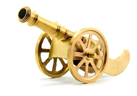 gunnery: isolated golden canon on white