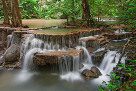 Huay Mae Khamin Waterfall Sixth Level, Paradise waterfall in Tropical rain forest of Thailand photo
