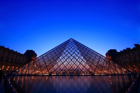 PARIS-APRIL 16,2010: Silhouette of Louvre pyramid at Evening during the Summer Antiquities Exhibition. Louvre is the biggest Museum in Paris displayed over 60,000 square meters of exhibition space.