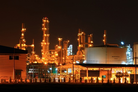petrochemical plant: closeup of  petrochemical oil refinery plant and water storage tank
