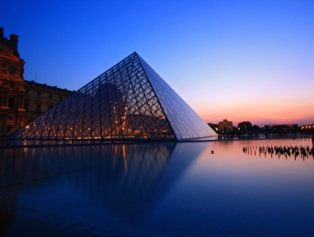 PARIS - APRIL 16,2010 : Closeup of Louvre Pyramid silhouette at dusk during the Summer Exhibition in Paris. Louvre is the biggest Museum in Paris displayed over 60,000 square meters of exhibition space.