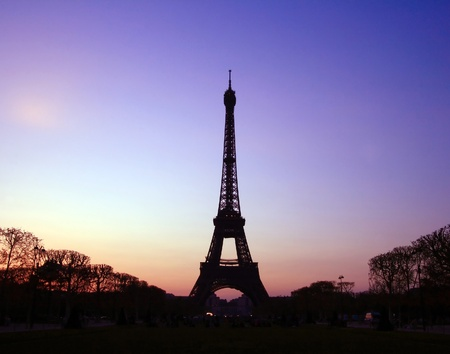 Silhouette of Eiffel Tower in the evening. The Eiffel tower is the most visited monument of France. photo