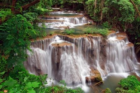 Huay Mae Khamin Waterfall, Paradise waterfall in Tropical rain forest of Thailand  photo