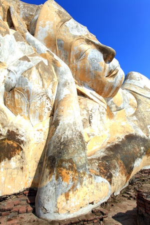 giant reclining buddha face statue over blue sky Stock Photo - 8967994