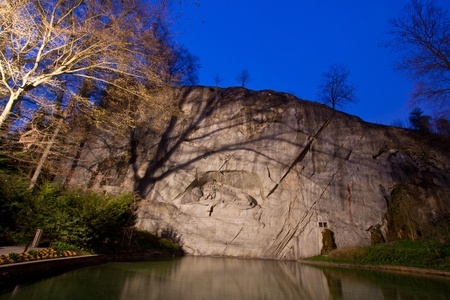 dying lion monument in Lucern Switzerland twilight photo