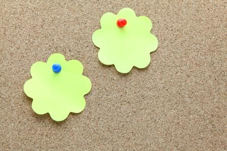 two flower shape memo paper on cork board photo