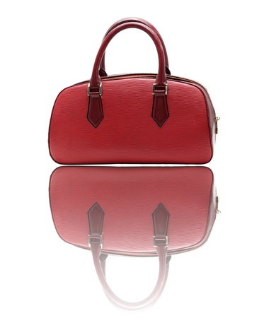 leather woman: red fake leather woman bag with its reflection Stock Photo