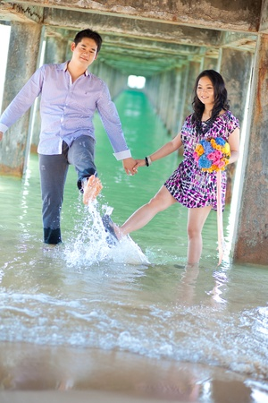 couples enjoy in the beach photo