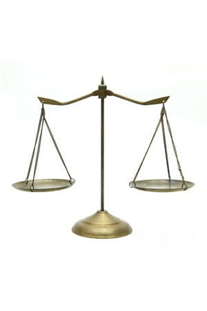 antique weight scale: golden brass scales of justice on white