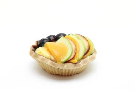 isolated mix fruit tart on white background photo