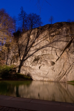 dying lion monument in Lucern Switzerland twilight, vertical photo
