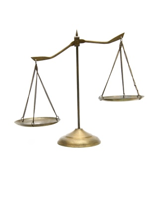 unbalance of golden brass scales of justice on white Stock Photo - 9136650