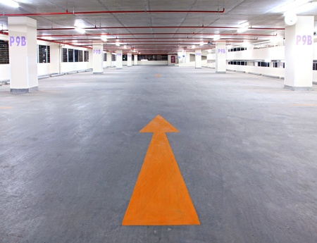 empty parking garage with yellow arrow Stock Photo - 9250476