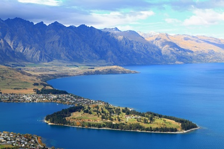 south island new zealand: closeup of queenstown with lake Wakatipu from top at noon.